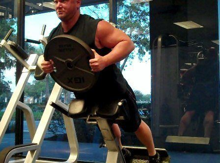 hyperextensions with 45 lb plate
