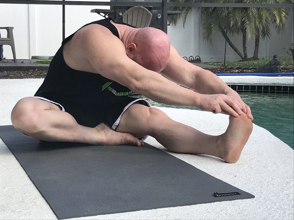 Hamstring hurdle stretch after leg day